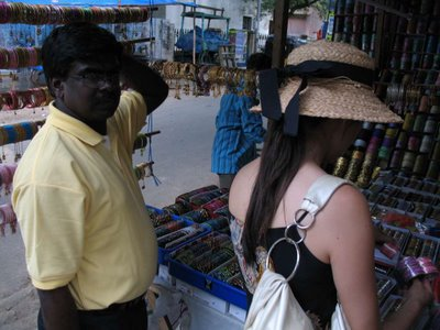 Raj helping Esther negotiate some bracelet prices at the market.